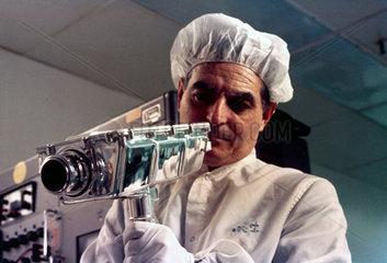 Technician assembling Apollo 9 television camera  1969.