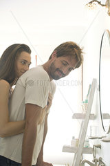 Woman embracing boyfriend from behind