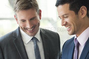 Businessmen talking and laughing together