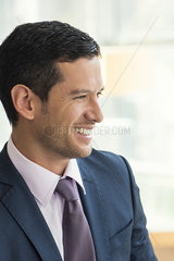Businessman looking away  smiling