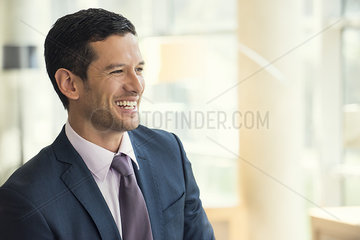 Businessman smiling cheerfully