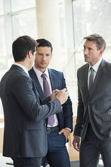 Businessmen engaged in serious discussion