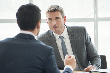Businessmen in serious meeting