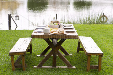 Picnic table set for meal outdoors