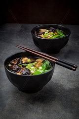 Japanese miso soup with sugar peas  shitake mushrooms  tofu and mung sprouts