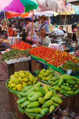 MANGOS. TOMATOES and CHILES for sale at the CENTRAL MARKET in KENGTUNG also known as KYAINGTONG  MYANMAR