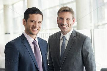 Businessmen smiling  portrait