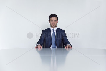Businessman seated at table  portrait