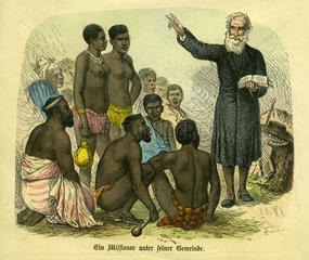 Weisser Missionar predigt den Eingeborenen in Afrika  1870