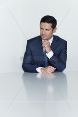 Businessman looking away in thought  portrait