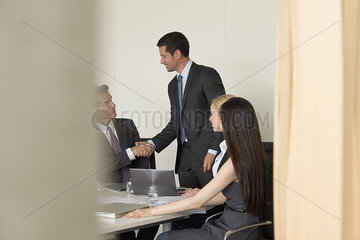 Executives meeting in conference room  viewed through doorway