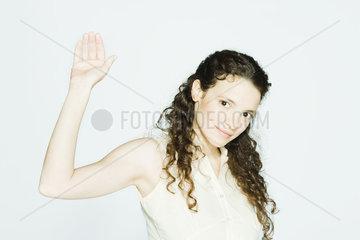 Young woman raising hand  portrait