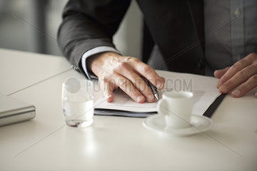 Businessman reviewing document  cropped