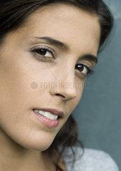Woman glancing sideways at camera  close-up
