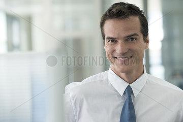 Businessman smiling cheerfully  portrait
