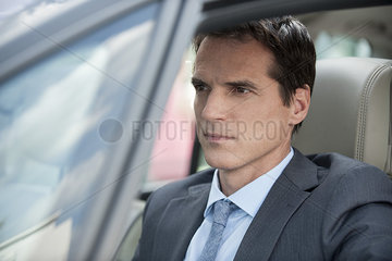 Businessman stuck in traffic