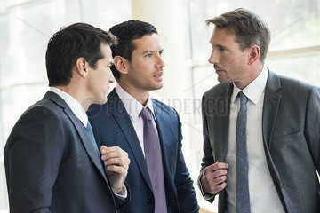 Businessmen having serious discussion