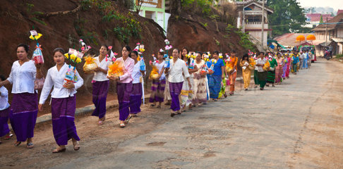 PROCESSION carrying household items for young men entering a Buddhist monastery in KENGTUNG also known as KYAINGTONG  MYANMAR