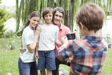 Boy photographing family