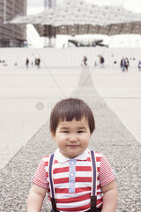 Baby boy in city square  portrait