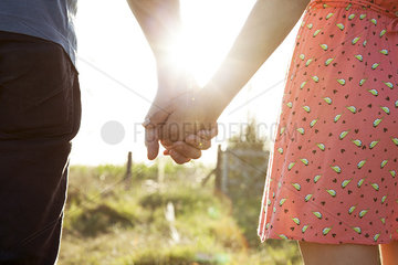 Couple holding hands  close-up