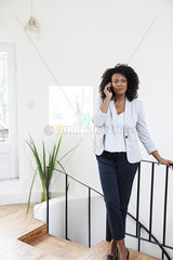 Businesswoman using cell phone