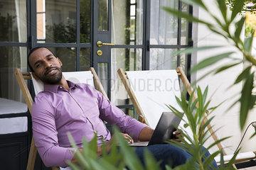 Man relaxing in deckchair
