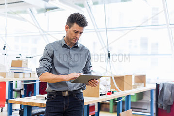 Man using tablet in factory