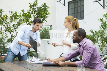 Businessman sharing good news with colleagues