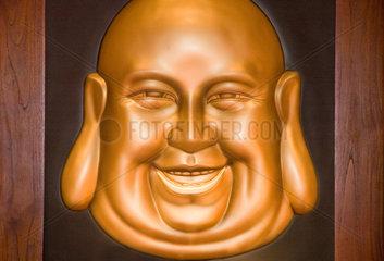 Berlin  Deutschland  lachendes  goldfarbenes Buddha-Antlitz