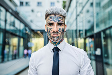 Young businessman with tattooed face  portrait