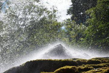 Water splashing over rock