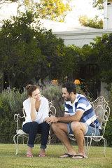 Couple enjoying tranquility of their backyard