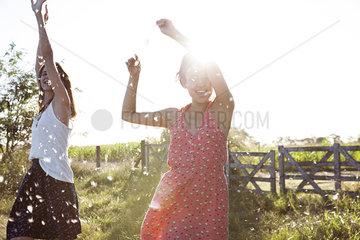 Friends dancing outdoors
