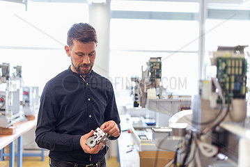 Man in factory examining product