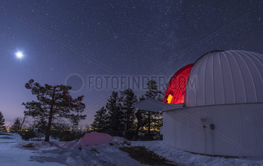 Moonlight illuminates the Schulman telescope on Mount Lemmon.