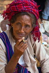 A SHAN WOMAN smokes a cigar at the YWAMA MARKET on the way to INDEIN  INLE LAKE  MYANMAR