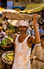 Market with locals selling fruit and vegetables in Daryagani in Old Delhi India