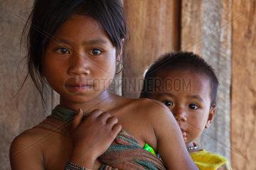 Siblings of the ANN TRIBE in a village near KENGTUNG or KYAINGTONG  MYANMAR