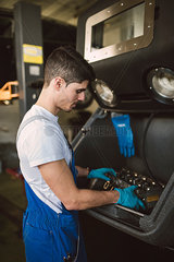 Mechanic working in his workshop
