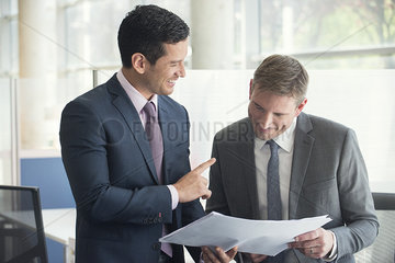 Businessmen discussing document together