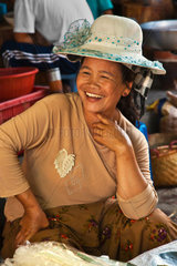 A BURMESE woman smiles while selling at the CENTRAL MARKET in KENGTUNG also known as KYAINGTONG  MYANMAR