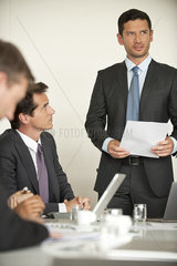 Businessman offering motivational speach at meeting