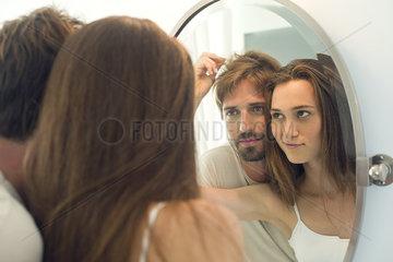 Woman suggesting husband needs haircut