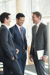 Businessmen having friendly conversation