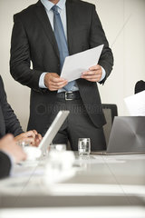 Businessman speaking at meeting