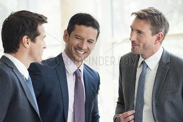 Businessmen having friendly conversation