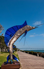 Giant Marlin statue at pier in Seaport Village at San Diego Bay in California