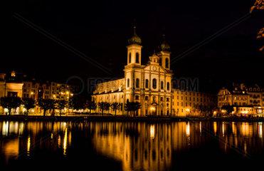 Beautiful night exposure of the lake and Jesuiten Church iun Lucerne Switzerland Luzern