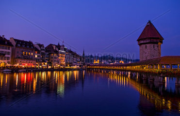 Night exposure of famous Kapelbrucke Bridge called Chapel Bridge at lake in Lucerne Switzerland Luzern